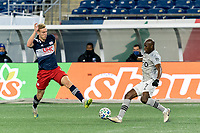 FOXBOROUGH, MA - NOVEMBER 20: Rod Fanni #7 of Montreal Impact dribbles as Adam Buksa #9 of New England Revolution defends during the Audi 2020 MLS Cup Playoffs, Eastern Conference Play-In Round game between Montreal Impact and New England Revolution at Gillette Stadium on November 20, 2020 in Foxborough, Massachusetts.