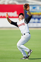 Shortstop Kyle Eveland #6 of the Kannapolis Intimidators tracks a fly ball into shallow left field against the Hagerstown Suns at Fieldcrest Cannon Stadium on May 30, 2011 in Kannapolis, North Carolina.   Photo by Brian Westerholt / Four Seam Images