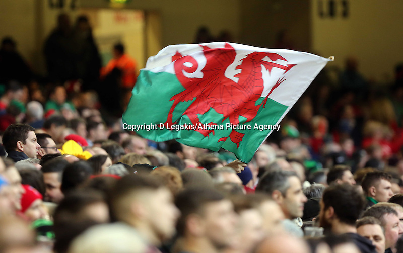Pictured: A welsh flag is flown in celebration to their win Saturday 14 March 2015<br /> Re: RBS Six Nations, Wales v Ireland at the Millennium Stadium, Cardiff, south Wales, UK.