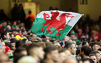 Pictured: A welsh flag is flown in celebration to their win Saturday 14 March 2015<br />
