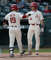 Arkansas designated hitter Charlie Welch (19) is congratulated at the plate Wednesday, April 7, 2021, by third baseman Cullen Smith after hitting a solo home run during the first inning of the Razorbacks' 10-3 win over UALR at Baum-Walker Stadium in Fayetteville. Visit nwaonline.com/210408Daily/ for today's photo gallery. <br /> (NWA Democrat-Gazette/Andy Shupe)