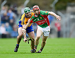 Brian Carey of Sixmilebridge in action against Michael Daffy of  Clooney-Quin during their senior county final at Cusack Park. Photograph by John Kelly.