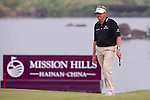 HAIKOU, CHINA - OCTOBER 31:  Colin Montgomerie of Scotland walks on the 18th green during day five of the Mission Hills Start Trophy at Mission Hills Resort on October 31, 2010 in Haikou, China.  The Mission Hills Star Trophy is Asia's leading leisure liflestyle event and features Hollywood celebrities and international golf stars. Photo by Victor Fraile / The Power of Sport Images