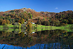 Great Britain, Cumbria, near Ambleside: Lake District National Park, Loughrigg Tarn in Autumn with Loughrigg Fell behind