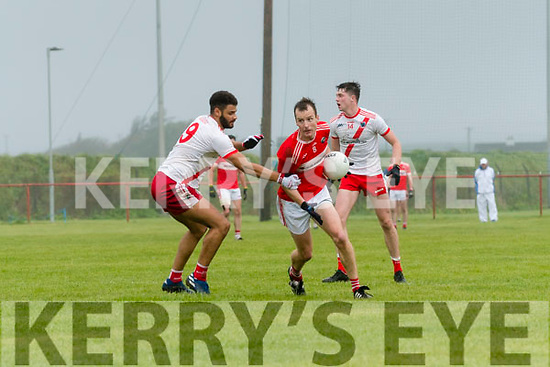Daingean Uí Chúis Darrach Ó Súilleabhain in possesion of the ball closely watched by An Ghaeltacht Franz Sauerland and Rob Ó Sé during the West Kerry Senior Football Championship Final at Gallarus on Sunday afternoon.