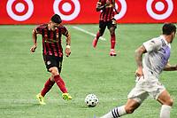 ATLANTA, GA - AUGUST 29: Manuel Castro #15 of Atlanta United passes the ball during a game between Orlando City SC and Atlanta United FC at Marecedes-Benz Stadium on August 29, 2020 in Atlanta, Georgia.