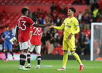 Teden Mengi of Manchester United and Brentford's Myles Peart-Harris shake hands at the final whistle during Manchester United vs Brentford, Friendly Match Football at Old Trafford on 28th July 2021