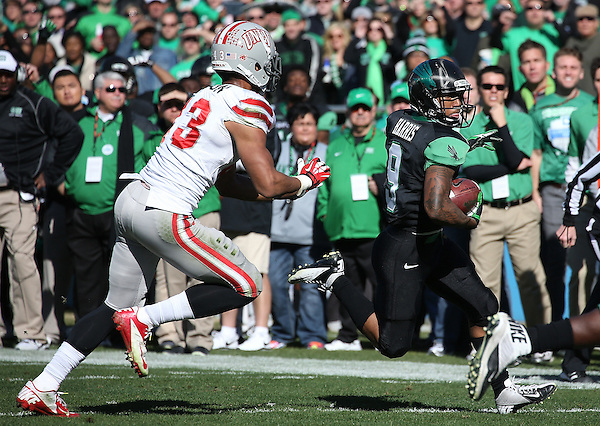 DENTON, TX  JANUARY 1: Carlos Harris #9 of the North Texas Mean Green evades Matt Lea #23 of the UNLV Rebels during the Heart of Dallas Bowl at Cotton Bowl Stadium in Dallas on January 1, 2014 in Dallas, TX.  Photo by Rick Yeatts North Texas won 36-14 over UNLV.