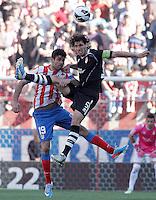 Atletico de Madrid's Diego Costa (l) and Granada's Diego Mainz during La Liga match.April 14,2013. (ALTERPHOTOS/Acero)