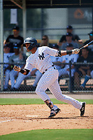 GCL Yankees East first baseman Starlin Paulino (6) hits a single during a game against the GCL Blue Jays on August 2, 2018 at Yankee Complex in Tampa, Florida.  GCL Yankees East defeated GCL Blue Jays 5-4.  (Mike Janes/Four Seam Images)