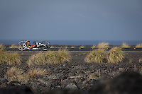 A Challenged Athlete hand cycled the lava fields the 2013 Ironman World Championship in Kailua-Kona, Hawaii on October 12, 2013.