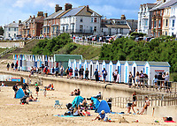 Southwold is an English resort town full of an olde world charm. The town is famous for its brightly colouredbeach huts, which total around 300 and stretch along the shore and past the iconic pier to both the north and south.<br /> Today there are believed to be around 20,000 beach huts in the U.K. Locations in other countries include Wimereux, France, Cape Town, South Africa, Nesodden, Norway and around the Melbourne coastline in Victoria, Australia. Southwold, Suffolk, UK July 12th 2020<br /> <br /> Photo by Keith Mayhew