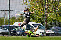 Estee Cattoor (11) of OHL jumps over goalkeeper of Lisa Musique (1) of Standard during a female soccer game between Standard Femina de Liege and Oud Heverlee Leuven on the 10th and last matchday in play off 1 of the 2020 - 2021 season of Belgian Scooore Womens Super League , saturday 29 th of May 2021  in Angleur , Belgium . PHOTO SPORTPIX.BE   SPP   SEVIL OKTEM