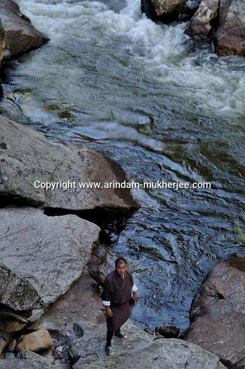 A bhutanese man at Mebartso or the burning lake at Bumthang. Arindam Mukherjee.