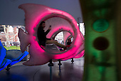 """New York, New York<br /> March 18, 2016<br /> <br /> The SeaGlass Carousel was born through the genius of wxy architecture. Inspired by the chambered nautilus, the spiraling pavilion of glass and steel brings art, architecture, and music to children of all ages.<br /> <br /> The George Tsypin Opera Factory created a mystical underwater experience. The rider sits within iridescent fish that glide through the sights and sounds of a 360° aquatic adventure.<br /> <br /> The 2,575 square foot pavilion—a huge chambered nautilus—designed by wxy architects spirals and shines amid The Battery's flora.<br /> <br /> SeaGlass lacks the center pole of a traditional carousel.  Instead, the four turntables are driven by electric motors housed below the floor.<br /> <br /> Each of the 30 massive fiberglass fish was custom designed and fabricated for SeaGlass by Show Canada. Internally illuminated with color-changing LED light fixtures and outfitted with integrated audio systems, each fish is designed to recall the bioluminescence found deep in the ocean.<br /> <br /> The show's underwater atmosphere is created through LED color-changing lighting combined with """"water effect"""" light projectors hung from a custom-designed helical light ring."""