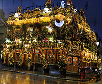 Kensington pub The Churchill Arms has made a name for itself as London's most festive pub thanks to its annual Christmas lights display. Close to 100 rows of christmas pinetrees are planted around the pub's perimeter and across its balconies and roof . And now the pub has reopened after lockdown, they celebrated by switching on the lights with over 25,000 twinkling bulbs. London December 3rd 2020<br /> <br /> Photo by Keith Mayhew