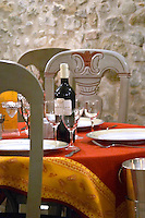 Carcassonne. At the Restaurant Auberge des Lices. Languedoc. France. Europe. Bottle. Wine glass.