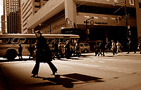 A pedestrian cross the street in front of the Bank of Montreal building on King Street West.. in downtown Toronto, April 20, 2007...   photo by Pierre Roussel - Images Distribution