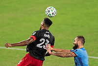 WASHINGTON, DC - SEPTEMBER 06: Donovan Pines #23 of D.C. United heads the ball away from Maxime Chanot #4 of New York City FC during a game between New York City FC and D.C. United at Audi Field on September 06, 2020 in Washington, DC.