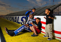 Sept. 5, 2011; Claremont, IN, USA: NHRA top fuel dragster driver Antron Brown poses for a portrait with his children after winning the US Nationals at Lucas Oil Raceway. Mandatory Credit: Mark J. Rebilas-