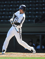Center fielder Luke Dauch (23) of the Northwestern Wildcats hits in a game against the Michigan State Spartans on Sunday, February 17, 2013, at Fluor Field at the West End in Greenville, South Carolina. Michigan State won, 7-4. (Tom Priddy/Four Seam Images)