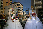 Mannequins dressed in wedding gowns and wearing protective face masks are pictured in Gaza City on March 25, 2020 amid the novel coronavirus pandemic. Photo by Osama Baba