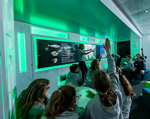 Áine O'Donnell, Aquaculture Remote Classroom (ARC) facilitator with students during a schools visit
