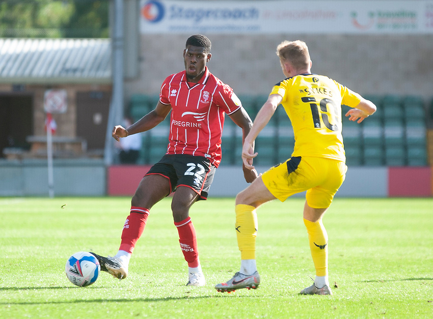 Lincoln City's Timothy Eyoma vies for possession with Oxford United's Mark Sykes<br /> <br /> Photographer Andrew Vaughan/CameraSport<br /> <br /> The EFL Sky Bet League One - Saturday 12th September  2020 - Lincoln City v Oxford United - LNER Stadium - Lincoln<br /> <br /> World Copyright © 2020 CameraSport. All rights reserved. 43 Linden Ave. Countesthorpe. Leicester. England. LE8 5PG - Tel: +44 (0) 116 277 4147 - admin@camerasport.com - www.camerasport.com - Lincoln City v Oxford United
