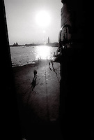 Couples walking along Venice Italy canal<br />