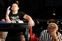 """Pat Baffa, in total concentration, waits for his opponent to step up to the table at the 28th Annual Big Apple Grapple, held in New York City on March 19, 2005.  The tournament is the first in the 2005 New York Arm Wrestling Association's """"Golden Arm Series""""."""