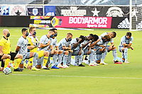 KANSAS CITY, UNITED STATES - AUGUST 25: Sporting KC players take a pre kick off kneel  a game between Houston Dynamo and Sporting Kansas City at Children's Mercy Park on August 25, 2020 in Kansas City, Kansas.