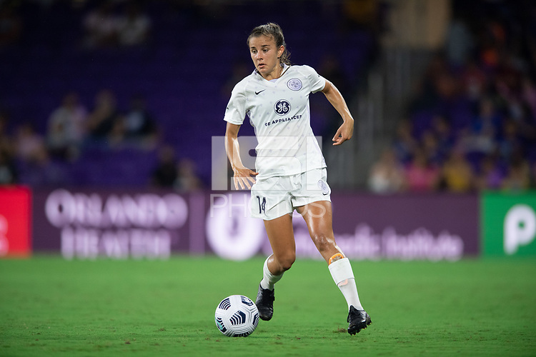 ORLANDO, FL - SEPTEMBER 11: Nealy Martin #14 of Racing Louisville FC dribbles the ball during a game between Racing Louisville FC and Orlando Pride at Exploria Stadium on September 11, 2021 in Orlando, Florida.