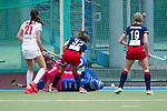 Mannheim, Germany, April 11: During the 1. Bundesliga women fieldhockey match between Mannheimer HC (blue) and Rot-Weiss Koeln (white) on April 11, 2021 at Am Neckarkanal in Mannheim, Germany. Final score 0-1 (HT 0-0). (Copyright Dirk Markgraf / www.265-images.com) *** Julia Sonntag #1 of Rot-Weiss Koeln, Martina Cavallero #32 of Mannheimer HC