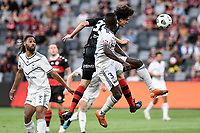 10th February 2021; Bankwest Stadium, Parramatta, New South Wales, Australia; A League Football, Western Sydney Wanderers versus Melbourne Victory; Mark Natta of Western Sydney Wanderers wins a header as Adam Traore of Melbourne Victory challenges