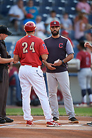 Mahoning Valley Scrappers hitting coach Jason Esposito meets with Williamsport Crosscutters hitting coach Christian Marrero (24), home plate umpire Kevin Mandzuk and umpire Sean Cassidy (not pictured) before a game against the Williamsport Crosscutters on August 28, 2018 at BB&T Ballpark in Williamsport, Pennsylvania.  Williamsport defeated Mahoning Valley 8-0.  (Mike Janes/Four Seam Images)