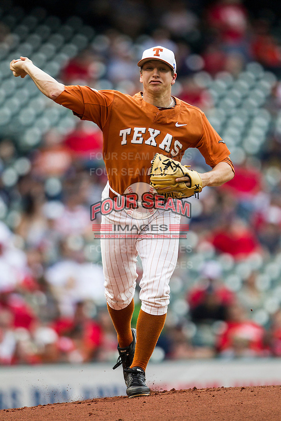 Texas Longhorns pitcher Parker French #24 makes a pickoff throw to first base during the NCAA baseball game against the Houston Cougars on March 1, 2014 during the Houston College Classic at Minute Maid Park in Houston, Texas. The Longhorns defeated the Cougars 3-2. (Andrew Woolley/Four Seam Images)