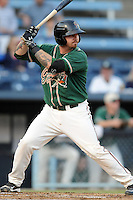 Greensboro Grasshoppers third baseman Josh Adams #10 swings at a pitch during game one of the South Atlantic League, Southern Division playoffs between the Greensboro Grasshoppers and the Asheville Tourists at McCormick Field on September 10, 2012 in Asheville, North Carolina . The Grasshoppers defeated the Tourists 6-3. (Tony Farlow/Four Seam Images).
