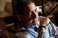 Glenn Greenwald speaks with an interviewer at the Hotel Marlowe in Cambridge, Massachusetts, USA. Greenwald is a lawyer, blogger, writer, and journalist, known most recently for his role in the Snowden NSA leaks. Greenwald recently received a Polk Award for National Security Reporting, and the 2014 Pulitzer Prize for Public Service.