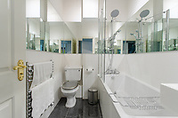 BNPS.co.uk (01202) 558833. <br /> Pic: Hamptons/BNPS<br /> <br /> The bathroom<br /> <br /> A grand mews house that was home to Henry Tate's art collection before he gifted it to the Tate Gallery is on the market for £1.8m.<br /> <br /> Henry Tate Mews is part of the former mansion that belonged to the sugar merchant in the late 1800s for 25 years.<br /> <br /> What is now an impressive Grade II* listed double height reception room was his billiard room where he displayed famous Pre-Raphaelite works of art including John Everett Millais' Ophelia.<br /> <br /> The five-bedroom house, which is on the market with Hamptons, also has shared access to the beautiful six acres of gardens that include an orchard, folly and a listed grotto.