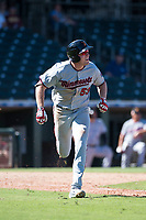 Salt River Rafters left fielder Luke Raley (53), of the Minnesota Twins organization, runs to first base during an Arizona Fall League game against the Surprise Saguaros on October 9, 2018 at Surprise Stadium in Surprise, Arizona. The Rafters defeated the Saguaros 10-8. (Zachary Lucy/Four Seam Images)