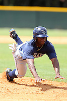 Tampa Bay Rays Deshun Dixon #36 slides head first into third during a spring training game against the Baltimore Orioles at the Buck O'Neil Complex on March 21, 2012 in Sarasota, Florida.  (Mike Janes/Four Seam Images)