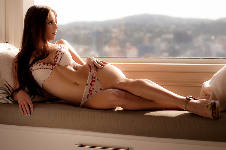 Lexxie Robinson relaxing with the Wellington summer view.
