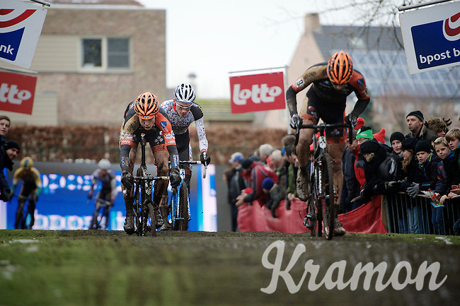 Mathieu Vanderpoel (NLD/BKCP-Powerplus) & Wout Van Aert (BEL/Vastgoedservice-Golden Palace) close in on Rob Peeters (BEL/Vastgoedservice-Golden Palace) on the pump track in lap 1 of the race<br /> <br /> Azencross Loenhout 2014