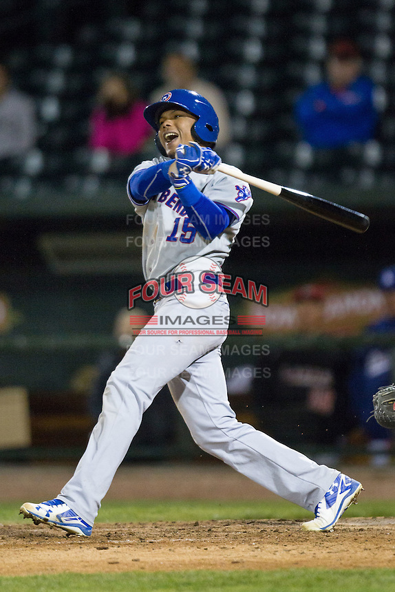 South Bend Cubs outfielder Eddy Martinez (15) follows through on his swing against the Great Lakes Loons on May 18, 2016 at Dow Diamond in Midland, Michigan. Great Lakes defeated South Bend 5-4. (Andrew Woolley/Four Seam Images)