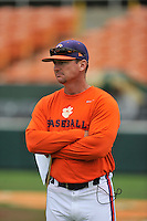 First-year head coach Monte Lee (18) of the Clemson Tigers watches his team in a fall practice intra-squad Orange-Purple scrimmage on Sunday, September 26, 2015, at Doug Kingsmore Stadium in Clemson, South Carolina. (Tom Priddy/Four Seam Images)