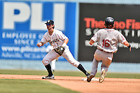 Asheville Tourists shortstop Brendan Rodgers (1) waits for a throw as Tate Matheny (16) runs to second during a game against the Greenville Drive at McCormick Field on July 24, 2016 in Asheville, North Carolina. The Drive defeated the Tourists 12-5. (Tony Farlow/Four Seam Images)