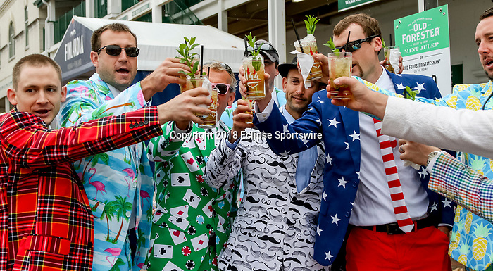 LOUISVILLE, KY - MAY 05: Men in fancy patterned suits cheer with their Mint Juleps on Kentucky Derby Day at Churchill Downs on May 5, 2018 in Louisville, Kentucky. (Photo by Mary Meek/Eclipse Sportswire/Getty Images)