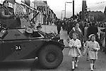 Belfast Orange Day Parade, British Army  keep watch. 1970.