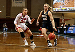 SIOUX FALLS, SD - MARCH 6: Keni Jo Lippe #33 of the Oral Roberts Golden Eagles drives past Jeniah Ugofsky #30 of the South Dakota Coyotes during the Summit League Basketball Tournament at the Sanford Pentagon in Sioux Falls, SD. (Photo by Dave Eggen/Inertia)
