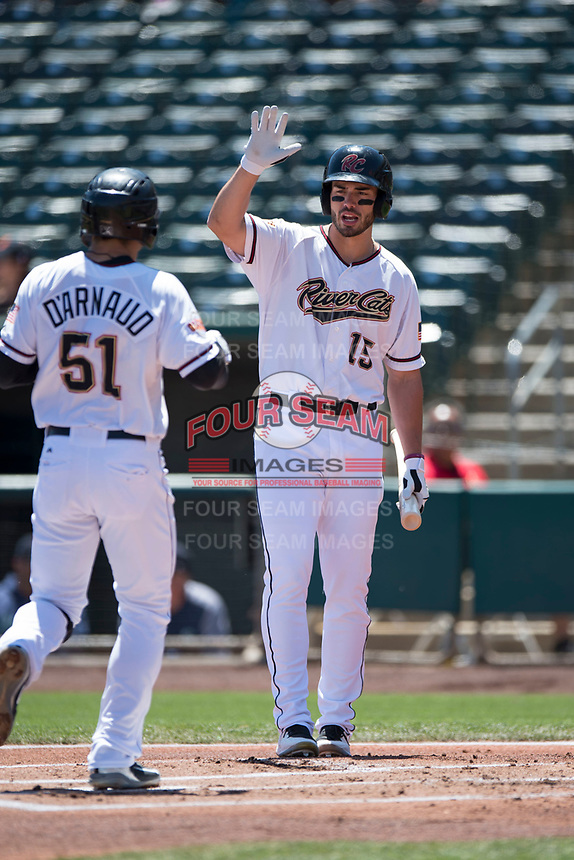 Sacramento RiverCats left fielder Chris Shaw (15) congratulates Chase D'Arnaud (51) after hitting a home run during a Pacific Coast League against the Tacoma Rainiers at Raley Field on May 15, 2018 in Sacramento, California. Tacoma defeated Sacramento 8-5. (Zachary Lucy/Four Seam Images)